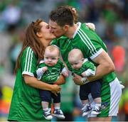 "A family moment. Séamus Hickey, one of the senior members of the squad, savours the moment with his wife Ellen and sons Matthew and Patrick on the pitch afterwards.    This image may be reproduced free of charge when used in conjunction with a review of the book ""A Season of Sundays 2018"". All other usage © SPORTSFILE"
