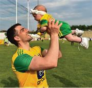 "Clear blue skies, a championship win and now time for family. Donegal's Paddy McGrath celebrates with his three-month-old daughter Isla Rose after a win over Derry.    This image may be reproduced free of charge when used in conjunction with a review of the book ""A Season of Sundays 2018"". All other usage © SPORTSFILE"