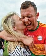 "Shocks in Leinster. One wonders who can mount a serious challenge to Dublin after Kildare and Meath, two counties with populations to challenge the Dubs, are dumped out of the Leinster championship. Their conquerors are Carlow and Longford, who have made steady progress in recent seasons with fewer resources. Here, Carlow's Darragh Foley receives the congratulations of his girlfriend Shona Delaney after a famous win in Tullamore while Meath's James McEntee lets fly before the arrival of David McGivney in Longford.    This image may be reproduced free of charge when used in conjunction with a review of the book ""A Season of Sundays 2018"". All other usage © SPORTSFILE"