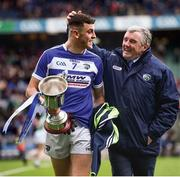 """Official seal of approval. With Laois fortunes taking a turn for the better following promotion and a win over Carlow in the Division Four final, Robert Pigott gets a pat on the head from county board chairman Lawrence Phelan for a job well done.    This image may be reproduced free of charge when used in conjunction with a review of the book """"A Season of Sundays 2018"""". All other usage © SPORTSFILE"""