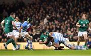 10 November 2018; Sean O'Brien of Ireland, who left the pitch with an injury as a result of the challenge, is tackled by Guido Petti, left, and Santiago Medrano of Argentina during the Guinness Series International match between Ireland and Argentina at the Aviva Stadium in Dublin. Photo by Matt Browne/Sportsfile