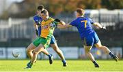 11 November 2018; Jason Leonard of Corofin in action against Dylan Summer, left, and Shane Pettit of Clann na nGael during the AIB Connacht GAA Football Senior Club Championship semi-final match between Clann na nGael and Corofin at Dr. Hyde Park in Roscommon. Photo by Ramsey Cardy/Sportsfile
