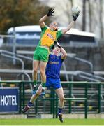 11 November 2018; Kieran Molloy of Corofin wins back possession from Emmet Kenny of Clann na nGael to set up his side's second goal during the AIB Connacht GAA Football Senior Club Championship semi-final match between Clann na nGael and Corofin at Dr. Hyde Park in Roscommon. Photo by Ramsey Cardy/Sportsfile