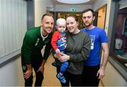13 November 2018; Fionn McKenna, age 2, from Mornington, Co Meath, with parents Lyndsey and Jason, and David Meyler of Republic of Ireland during a visit from the Republic of Ireland and Northern Ireland players to Our Lady's Children's Hospital at St John's Ward Our Lady's Children's Hospital in Crumlin, Dublin. Photo by David Fitzgerald/Sportsfile