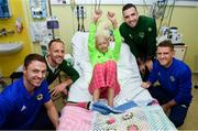 13 November 2018; Freya Fitzpatrick, age 13, from Dublin, with players, from left, Jonny Evans of Northern Ireland, David Meyler of Republic of Ireland, Shane Duffy of Republic of Ireland and Steven Davis of Northern Ireland during a visit to Our Lady's  Children's Hospital at St John's Ward Our Lady's Children's Hospital in Crumlin, Dublin. Photo by David Fitzgerald/Sportsfile