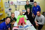 13 November 2018; Freya Fitzpatrick, age 13, from Dublin, with her parents Aidan and Emma and players, from left, Jonny Evans of Northern Ireland, David Meyler of Republic of Ireland, Shane Duffy of Republic of Ireland and Steven Davis of Northern Ireland during a visit from Republic of Ireland and Northern Ireland players to Our Lady's  Children's Hospital at St John's Ward Our Lady's Children's Hospital in Crumlin, Dublin. Photo by David Fitzgerald/Sportsfile