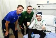 13 November 2018; Callum Friel, age 15, Creeslaugh, Co Donegal, with players, Jonny Evans of Northern Ireland, left, and Shane Duffy of Republic of Ireland during a visit from Republic of Ireland and Northern Ireland players to Our Lady's Children's Hospital at St John's Ward Our Lady's Children's Hospital in Crumlin, Dublin. Photo by David Fitzgerald/Sportsfile
