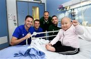 13 November 2018; Sophia Chiau, age 6, from Enniscorthy, Co Wexford, with players, from left, Jonny Evans and Steven Davis of Northern Ireland and David Meyler and Shane Duffy of Republic of Ireland during a visit to Our Lady's Children's Hospital from Republic of Ireland and Northern Ireland players at St John's Ward Our Lady's Children's Hospital in Crumlin, Dublin. Photo by David Fitzgerald/Sportsfile