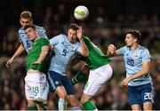 15 November 2018; Darragh Lenihan of the Republic of Ireland in action against Jonny Evans and Gareth McAuley and Craig Cathcart of Northern Ireland during the International Friendly match between Republic of Ireland and Northern Ireland at the Aviva Stadium in Dublin. Photo by Seb Daly/Sportsfile