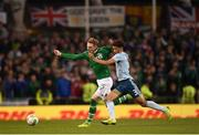 15 November 2018; Ronan Curtis of Republic of Ireland in action against Jamal Lewis of Northern Ireland during the International Friendly match between Republic of Ireland and Northern Ireland at the Aviva Stadium in Dublin. Photo by Stephen McCarthy/Sportsfile