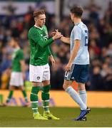 15 November 2018; Ronan Curtis of Republic of Ireland and Craig Cathcart of Northern Ireland following the International Friendly match between Republic of Ireland and Northern Ireland at the Aviva Stadium in Dublin. Photo by Seb Daly/Sportsfile
