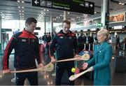16 November 2018; Cork and Clare hurlers departed Dublin Airport for Boston today onboard an Aer Lingus flight. Aer Lingus, Title Sponsor and Official Airline of the Aer Lingus Fenway Hurling Classic, is thrilled to once again be supporting this unique cultural and sporting event, bringing four teams and 130 hurlers to Boston's famous Fenway Park. Games will be broadcast on TG4 on Sunday, November 18th with Wexford v Limerick in the first semi-final and Clare v Cork in the second semi-final. Pictured at the Aer Lingus Fenway Hurling Classic - Send Off is Cork hurlers, Séamus Harnedy and Damien Cahalane with Aer Lingus staff member Jordyn Boyle at Dublin Airport, Dublin. Photo by Eóin Noonan/Sportsfile