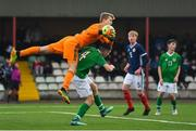 16 November 2018; Scotland goalkeeper Jay Hogarth collects a high ball from Oisin Hand of Republic of Ireland during the U16 Victory Shield match between Republic of Ireland and Scotland at Mounthawk Park in Tralee, Kerry. Photo by Brendan Moran/Sportsfile