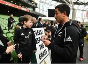16 November 2018; Anton Lienert-Brown of New Zealand signs an autograph for Conor Hogan, age 6, from Ashbourne, Co Meath following the Captain's Run and Press Conference at the Aviva Stadium in Dublin. Photo by David Fitzgerald/Sportsfile