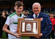 16 November 2018; Owen Aiston, Chairman of SAFIB, presents the Victory Shield to Northern Ireland captain Conor Bradley after the U16 Victory Shield match between Northern Ireland and Wales at Mounthawk Park in Tralee, Kerry. Photo by Brendan Moran/Sportsfile