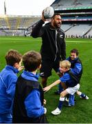 16 November 2018; World Rugby Champions, New Zealand All Blacks and Dublin GAA senior players were in Croke Park today at the AIG Heroes event, a CSR initiative to help support local grassroots communities by using their sporting partnerships with Dublin GAA and others to promote sport as a means to build self-confidence and social skills in young kids. As part of the visit to Croke Park, AIG also gifted primary schools in the area with sports equipment. AIG is proud sponsor of Dublin GAA and New Zealand Rugby. Pictured is Patrick Tuipulotu of New Zealand All Blacks with attendees during the AIG Heroes Event at Croke Park, Dublin. Photo by Sam Barnes/Sportsfile