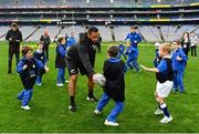 16 November 2018; World Rugby Champions, New Zealand All Blacks and Dublin GAA senior players were in Croke Park today at the AIG Heroes event, a CSR initiative to help support local grassroots communities by using their sporting partnerships with Dublin GAA and others to promote sport as a means to build self-confidence and social skills in young kids. As part of the visit to Croke Park, AIG also gifted primary schools in the area with sports equipment. AIG is proud sponsor of Dublin GAA and New Zealand Rugby. Pictured is Patrick Tuipulotu of New Zealand All Blacks  of New Zealand All Blacks with attendees during the AIG Heroes Event at Croke Park, Dublin. Photo by Sam Barnes/Sportsfile