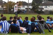 17 November 2018; Dublin All-Ireland winner and All-Star Paul Mannion puts the Ballyboden under 13 boys' football team through their paces. The team were selected as winners of the John West competition as part of their sponsorship of the Feile. John West has sponsored the Feile since 2016 and throughout the sponsorship, John West has focused on encouraging children to participate in Gaelic Games while emphasising the importance natural protein plays in fuelling a young athlete. Pictured is Paul Mannion speaking with young players during the John West Training Session with Paul Mannion at Ballyboden St Endas GAA in Ballyboden, Dublin. Photo by Eóin Noonan/Sportsfile