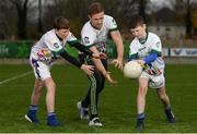 17 November 2018; Dublin All-Ireland winner and All-Star Paul Mannion puts the Ballyboden under 13 boys' football team through their paces. The team were selected as winners of the John West competition as part of their sponsorship of the Feile. John West has sponsored the Feile since 2016 and throughout the sponsorship, John West has focused on encouraging children to participate in Gaelic Games while emphasising the importance natural protein plays in fuelling a young athlete. Pictured is Paul Mannion with Luke Fitzpatrick, age 13, from Knocklyon, left, and Ryan Culleton age 13, from Rathfarnham, during the John West Training Session with Paul Mannion at Ballyboden St Endas GAA in Ballyboden, Dublin. Photo by Eóin Noonan/Sportsfile