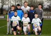 17 November 2018; Dublin All-Ireland winner and All-Star Paul Mannion puts the Ballyboden under 13 boys' football team through their paces. The team were selected as winners of the John West competition as part of their sponsorship of the Feile. John West has sponsored the Feile since 2016 and throughout the sponsorship, John West has focused on encouraging children to participate in Gaelic Games while emphasising the importance natural protein plays in fuelling a young athlete. Pictured is Paul Mannion, centre, with from left, Alex Young, age 13, from Knocklyon, Dylan Timbs, age 13, from Rathfarmham, Sean Langan, age 13, also from Rathfarnham, Luke Nicholson, age 13, Leon Murphy, age 13, Luke Fitzpatrick, age 13, all from Knocklyon and Ryan Culleton age 13, from Rathfarnham, during the John West Training Session with Paul Mannion at Ballyboden St Endas GAA in Ballyboden, Dublin. Photo by Eóin Noonan/Sportsfile