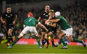 17 November 2018; Damian McKenzie of New Zealand is tackled by Josh van der Flier, left, and Rory Best of Ireland during the Guinness Series International match between Ireland and New Zealand at the Aviva Stadium in Dublin. Photo by David Fitzgerald/Sportsfile