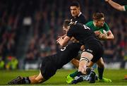 17 November 2018; Garry Ringrose of Ireland is tackled by Jack Goodhue, left, and Brodie Retallick of New Zealand during the Guinness Series International match between Ireland and New Zealand at the Aviva Stadium in Dublin. Photo by Ramsey Cardy/Sportsfile
