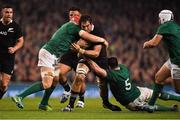 17 November 2018; Sam Whitelock of New Zealand is tackled by Josh van der Flier and James Ryan, right, of Ireland during the Guinness Series International match between Ireland and New Zealand at the Aviva Stadium in Dublin. Photo by Brendan Moran/Sportsfile