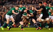 17 November 2018; Bundee Aki of Ireland is tackled by Ryan Crotty, left, and Beauden Barrett of New Zealand during the Guinness Series International match between Ireland and New Zealand at the Aviva Stadium in Dublin. Photo by Ramsey Cardy/Sportsfile