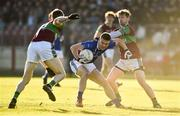 18 November 2018; Conor McCarthy of Scotstown in action against Niall Holly and Ciaran Lenehan of Eoghan Rua Coleraine during the AIB Ulster GAA Football Senior Club Championship semi-final match between Eoghan Rua Coleraine and Scotstown at Healy Park in Omagh, Tyrone. Photo by Oliver McVeigh/Sportsfile