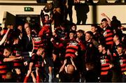 18 November 2018; Ballygunner players celebrate as supporter Ryan McCarthy, aged 8, lifts the cup after the AIB Munster GAA Hurling Senior Club Championship Final between Na Piarsaigh and Ballygunner at Semple Stadium in Thurles, Co. Tipperary. Photo by Diarmuid Greene/Sportsfile