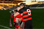 18 November 2018; Ballygunner joint captain Shane O'Sullivan celebrates with his 2-year-old son Ferdia and his partner Ciara after the AIB Munster GAA Hurling Senior Club Championship Final between Na Piarsaigh and Ballygunner at Semple Stadium in Thurles, Co. Tipperary. Photo by Diarmuid Greene/Sportsfile