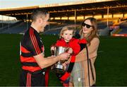 18 November 2018; Ferdia O'Sullivan, aged 2, refuses to give the cup back to his father, Ballygunner joint captain Shane O'Sullivan, as he celebrates with his partner Ciara after the AIB Munster GAA Hurling Senior Club Championship Final between Na Piarsaigh and Ballygunner at Semple Stadium in Thurles, Co. Tipperary. Photo by Diarmuid Greene/Sportsfile