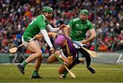 18 November 2018; Jack O'Connor of Wexford in action against Kyle Hayes, left, and Richie English of Limerick during the Aer Lingus Fenway Hurling Classic 2018 semi-final match between Limerick and Wexford at Fenway Park in Boston, MA, USA. Photo by Piaras Ó Mídheach/Sportsfile