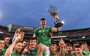 18 November 2018; Limerick captain Declan Hannon is held aloft by his team mates as they celebrate with the Players Champions Cup after winning the Aer Lingus Fenway Hurling Classic 2018 Final match between Cork and Limerick at Fenway Park in Boston, MA, USA. Photo by Piaras Ó Mídheach/Sportsfile