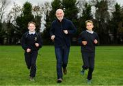 19 November 2018; Ray D'Arcy, RTE Radio DJ with students from Scoil Na Mainistreach, Adam Bradley, age 11, from Celbridge, Kildare, left, and Mateusz Stawski, age 12, from Celbridge, Kildare at The Daily Mile Launch Kildare at Scoil Na Mainistreach in Celbridge, Co Kildare. Photo by Eóin Noonan/Sportsfile