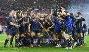 "12 May 2018; The Leinster team celebrate with the cup after the European Rugby Champions Cup Final match between Leinster and Racing 92 at the San Mames Stadium in Bilbao, Spain. This image may be reproduced free of charge when used in conjunction with a review of the book ""Double Delight"". All other usage © SPORTSFILE."