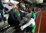 19 November 2018; Michael Obafemi of Republic of Ireland with his mother Bola and brother Affy following the UEFA Nations League B group four match between Denmark and Republic of Ireland at Ceres Park in Aarhus, Denmark. Photo by Stephen McCarthy/Sportsfile