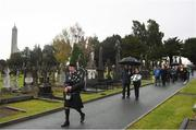 21 November 2018; Piper Pat Nolan in front of Uachtarán Chumann Lúthchleas Gael John Horan, left, and GAA Communications Officer Siobhan Brady lead the procession to the unveiling of a memorial headstone to Bloody Sunday victim John William Scott who was shot and killed aged 14 at Croke Park at Glasnevin Cemetery in Dublin. Photo by David Fitzgerald/Sportsfile