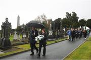 21 November 2018; Uachtarán Chumann Lúthchleas Gael John Horan, left, and GAA Communications Officer Siobhan Brady lead the procession to the unveiling of a memorial headstone to Bloody Sunday victim John William Scott who was shot and killed aged 14 at Croke Park at Glasnevin Cemetery in Dublin. Photo by David Fitzgerald/Sportsfile