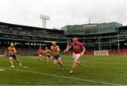 18 November 2018; Damien Cahalane of Cork gets away from Shane Golden, centre, and Aron Shanagher of Clare  during the Aer Lingus Fenway Hurling Classic 2018 semi-final match between Clare and Cork at Fenway Park in Boston, MA, USA. Photo by Piaras Ó Mídheach/Sportsfile