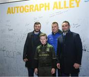 23 November 2018; Daniel Hall, aged 10, from Rathmines, Co. Dublin, poses for a photo with Robbie Henshaw, Seán O'Brien and Dave Kearney of Leinster in Autograph Alley at the Guinness PRO14 Round 9 match between Leinster and Ospreys at the RDS Arena in Dublin. Photo by Harry Murphy/Sportsfile
