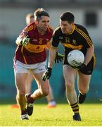 25 November 2018; Gavin White of Dr Crokes in action against Eoin Cleary of St Joseph's Miltown Malbay during the AIB Munster GAA Football Senior Club Championship Final match between Dr. Crokes and St. Josephs Miltown Malbay at the Gaelic Grounds in Limerick. Photo by Eóin Noonan/Sportsfile