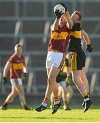 25 November 2018; Conor Cleary of St Joseph's Miltown Malbay in action against Johnny Buckley of Dr Crokes during the AIB Munster GAA Football Senior Club Championship Final match between Dr. Crokes and St. Josephs Miltown Malbay at the Gaelic Grounds in Limerick. Photo by Eóin Noonan/Sportsfile