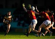 25 November 2018; Micheál Burns of Dr Crokes scores a point despite the efforts of Gordon Kelly, left, and Oisin Looney of St Joseph's Miltown Malbay during the AIB Munster GAA Football Senior Club Championship Final match between Dr. Crokes and St. Josephs Miltown Malbay at the Gaelic Grounds in Limerick. Photo by Eóin Noonan/Sportsfile