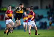 25 November 2018; Micheál Burns of Dr Crokes is tackled by Brian Curtin of St Joseph's Miltown Malbay during the AIB Munster GAA Football Senior Club Championship Final match between Dr. Crokes and St. Josephs Miltown Malbay at the Gaelic Grounds in Limerick. Photo by Eóin Noonan/Sportsfile