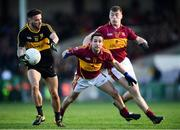 25 November 2018; Micheál Burns of Dr Crokes in action against Brian Curtin, left, and Kieran Malone  of St Joseph's Miltown Malbay during the AIB Munster GAA Football Senior Club Championship Final match between Dr. Crokes and St. Josephs Miltown Malbay at the Gaelic Grounds in Limerick. Photo by Eóin Noonan/Sportsfile