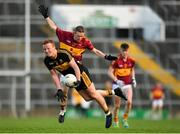 25 November 2018; Johnny Buckley of Dr Crokes is tackled by Eoin Curtin of St Joseph's Miltown Malbay during the AIB Munster GAA Football Senior Club Championship Final match between Dr. Crokes and St. Josephs Miltown Malbay at the Gaelic Grounds in Limerick. Photo by Eóin Noonan/Sportsfile