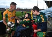25 November 2018; Corofin supporter Tomas McLoughlin, age 8, from Corofin, with Mike Farragher, left, and Dylan Wall following the AIB Connacht GAA Football Senior Club Championship Final match between Ballintubber and Corofin at Elvery's MacHale Park in Castlebar, Mayo. Photo by David Fitzgerald/Sportsfile