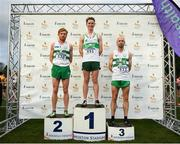 25 November 2018; Race winner Kevin Dooney of Raheny Shamrock A.C., centre, with second place Sean Tobin, left and Kevin Maunsell, right, of Clonmel A.C. after the Senior Men's 10,000m during the Irish Life Health National Senior & Junior Cross Country Championships at National Sports Campus in Abbottstown, Dublin. Photo by Harry Murphy/Sportsfile
