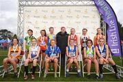 25 November 2018;  Girls U14 2,000m first 12 finishers pictured with Georgina Drumm, President of Athletics Ireland during the Irish Life Health National Senior & Junior Cross Country Championships at National Sports Campus in Abbottstown, Dublin. Photo by Harry Murphy/Sportsfile